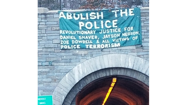 Activists hang 'Abolish the Police' banner on West Rock Tunnel