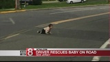 Driver finds baby crawling across busy road&#x3b; child unharmed