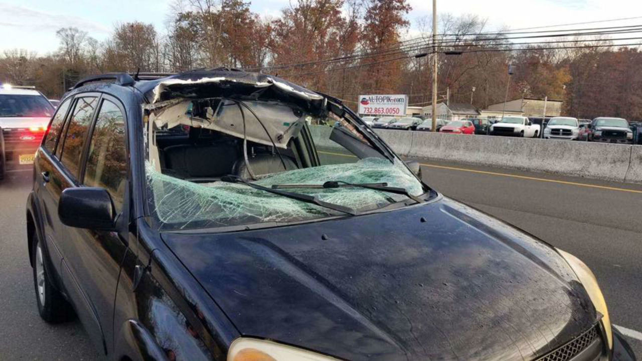 Airborne deer smashes through NJ woman's windshield, into