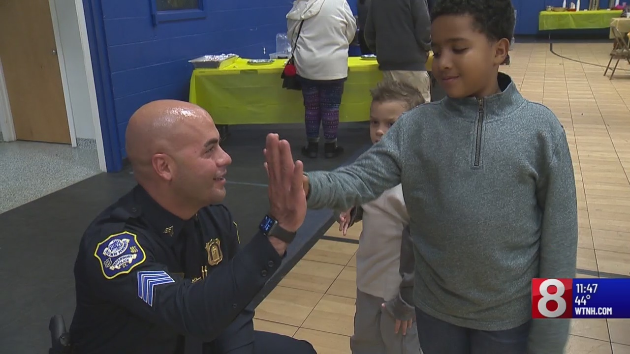 Waterbury police, community youth come together for a holiday gathering