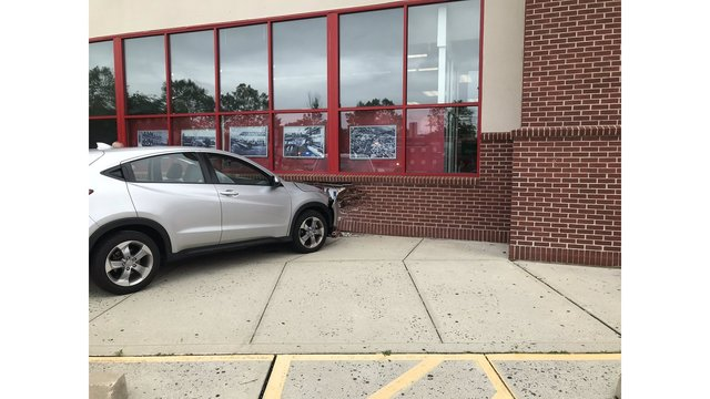 2 injured after car crashes through Norwalk CVS